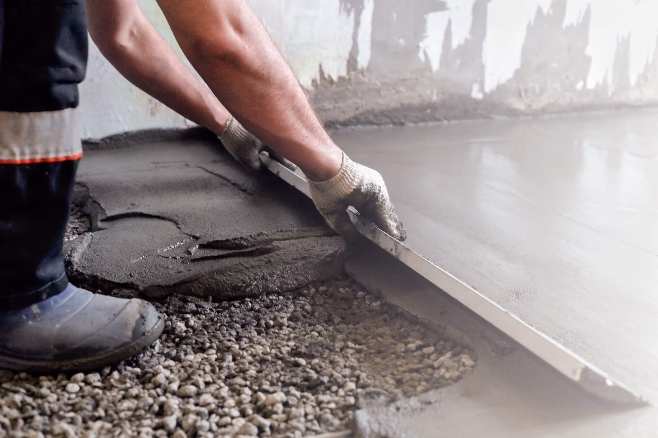 Worker Shaping Concrete